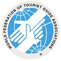 Logo of World Federation of Tourist Guid Association to ilustrate the quality of the Orsay Museum Guided Tour