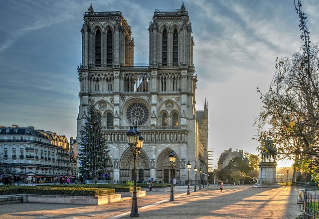 Photo of Notre-Dame facade in the morning in Ile de la Cité to illustrate a walking tour from Notre-Dame to Le Marais in Paris, France.
