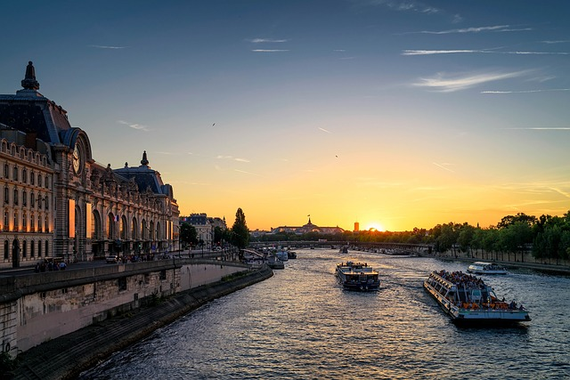 Twilight view of the Orsay Museum along the Seine River to illustrate an Orsay Museum Guided Tour in Paris, France.