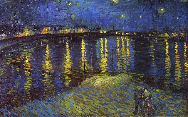"""Photo of the oil painting Starry Night Over the Rhône """"la nuit étoilée sur le Rhone"""" by Vincent Van Gogh, to illustrate an Orsay Museum Guided Tour in Paris, France."""
