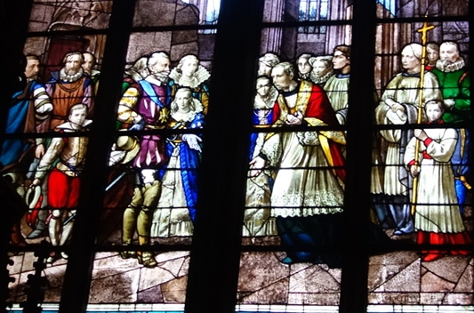 Photo of a stained glass of the Cathedral Sainte-Croix depicting the king of France Henri IV to illustrate an Orléans Cathedral guided tour in the Loire Valley, France.