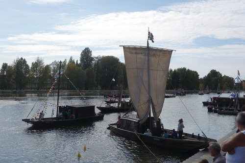Photo of traditional boats on the Loire River during the Loire festival. Orléans, Loire Valley, France.